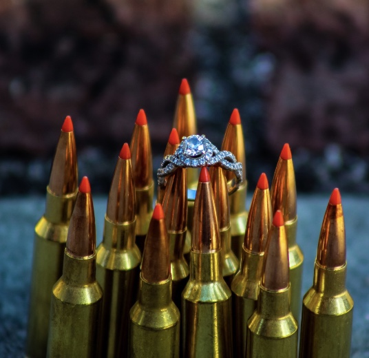 Kylie's engagement picture which shows her Princess cut engagement ring sitting on top of bullets. An odd picture for an odd family.